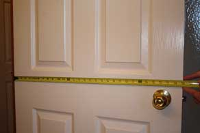 Measure the width of the door.