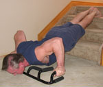 The Atlas push up bar using wide grip on three steps